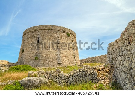 Torre den Penjat stone fort at Menorca, Spain.