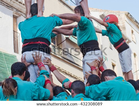 TORREDEMBARRA, SPAIN - JULY 13, 2014: Castells Performance   in Torredembarra, Catalonia, Spain. A Castell is a  Human Tower  built traditionally in Catalonia.