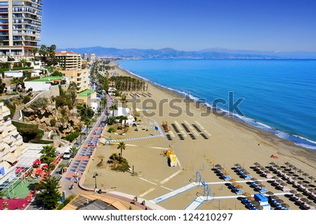 TORREMOLINOS, SPAIN - MARCH 13: Bajondillo Beach on March 13, 2012 in Torremolinos, Spain. This popular beach is about 1,100 meters long and 40 meters average width