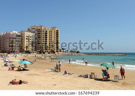 TORREVIEJA, SPAIN - MAY 25:Torrevieja is a Mediterranean city, with a privileged location and the unique climatic conditions. The beach area of the city in May 25, 2013 in Torrevieja