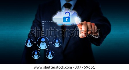 Torso of a business manager is directing his left hand to unlock a cloud icon by touch, thus opening a connection to a virtual work team of five remote white collar workers. Plenty of copy space. - stock photo