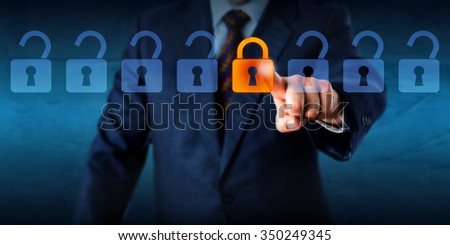 Torso of a manager is locking one virtual lock in a lineup of open padlocks. Business metaphor and technology concept for cyber security, critical data streaming, encryption and personal information. - stock photo
