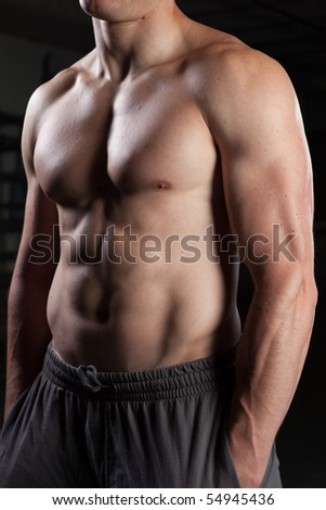 Torso of a shirtless guy standing - stock photo