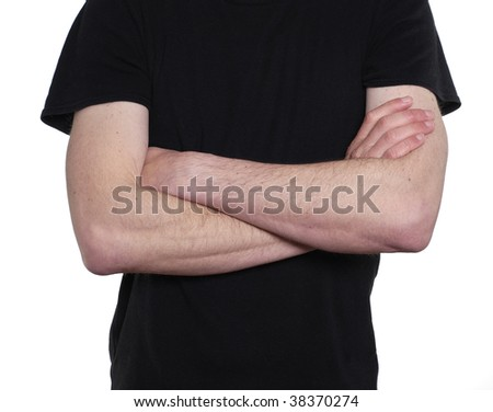 Torso of man wearing a plain black t-shirt with arms folded across his chest.