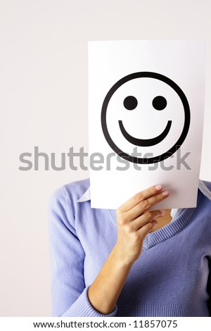 Torso of woman Keeping a Paper with Smiling Face - stock photo