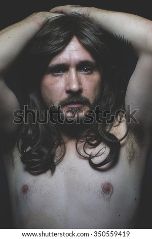 torso sexy naked man with long dark hair, intense eyes and blue eyes