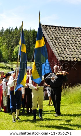TORSTUNA, SWEDEN - JUNE 22: Unidentified people in folklore ensemble in midsummer event. Official name is midsummer event hembygd Torstuna on June 22, 2012 in Torstuna Sweden - stock photo