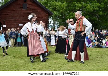 TORSTUNA, SWEDEN - JUNE 20: Unidentified people in folklore ensemble in midsummer event. The official name is midsummer event and organization are hembygd Torstuna on June 20, 2014 in Torstuna Sweden - stock photo