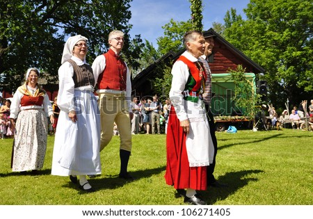 TORSTUNA, SWEDEN - JUNE 22: Unidentified people in folklore ensemble in traditional folk costume. The official name is midsummer event and org are hembygd Torstuna on June 22, 2012 in Torstuna Sweden