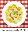 Tortellini Italian stuffed pasta with sauce and vegetables - stock photo
