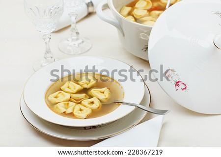 Tortellini soup - stock photo