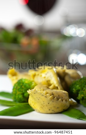 tortellini with mangetout and broccoli - stock photo