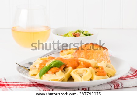 Tortelloni and rose sauce.  Useful on menus and other food services marketing. - stock photo