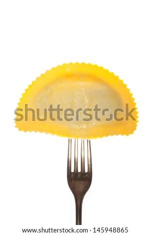 tortelloni pasta on a fork  - stock photo