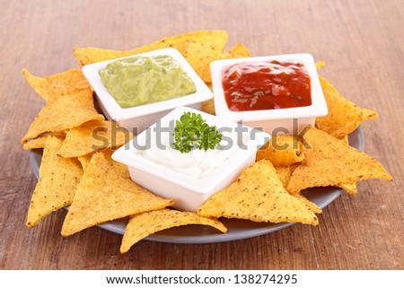 tortilla chips and dip - stock photo