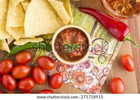 Tortilla chips  and dip on a kitchen table.