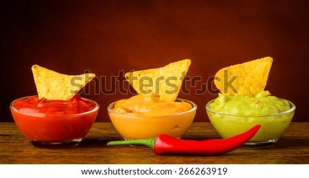 tortilla chips and nacho dip - stock photo