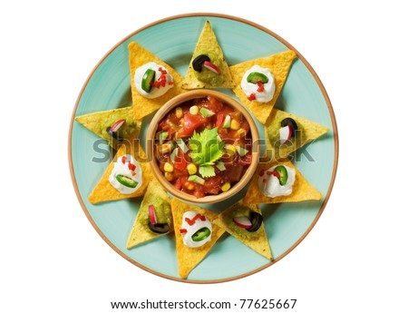 Tortilla chips arranged around a bowl of salsa - overhead - stock photo