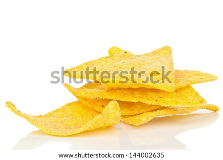 Tortilla chips in a small pile on a white background