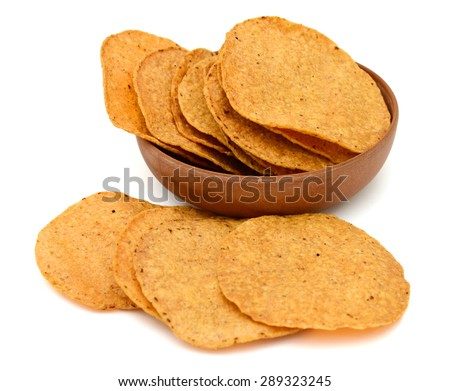 tortilla chips in bowl isolated on white  - stock photo