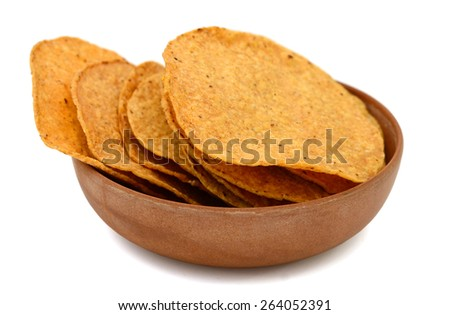 tortilla chips in bowl on white background - stock photo