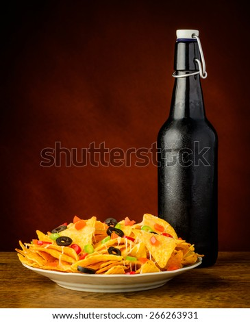 tortilla chips snack with cold beer bottle - stock photo