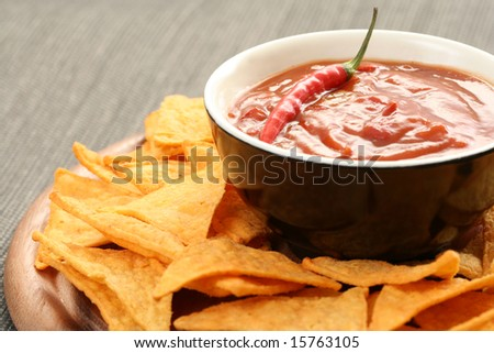 tortilla chips with hot salsa mexicana - party food - stock photo