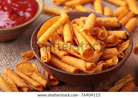 Tortilla chips with salsa dip - stock photo