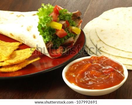 Tortilla, dip and nachos as mexican dish - stock photo