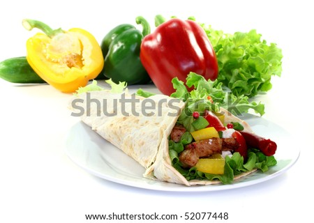 Tortilla filled with cheese, turkey breast and vegetables