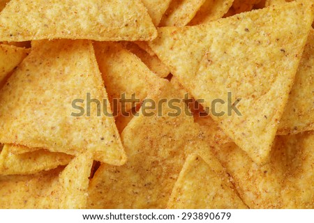 tortilla nachos background shot from above, good for backdrop - stock photo