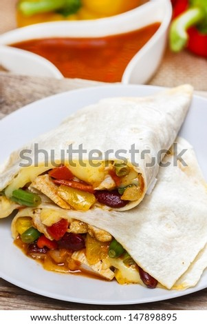 Tortilla on white plate, selective focus - stock photo