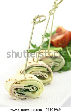 Tortilla stuffed with cheese and ham - stock photo