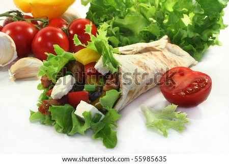 Tortilla stuffed with sheep's cheese, grilled turkey and vegetables - stock photo