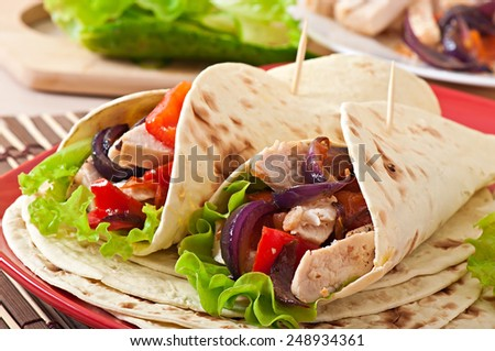 Tortilla with chicken and bell peppers - stock photo