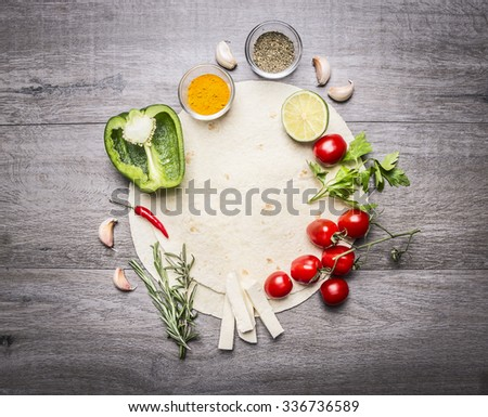 tortilla with laid out by around her fruits and vegetables space for text on grey wooden rustic background top view - stock photo