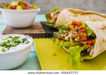 Tortilla with pulled pork, fresh vegetables  - stock photo