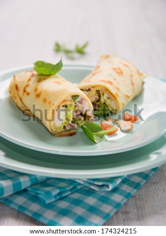 tortilla wrap a rollup of flatbread with assorted fillings - stock photo