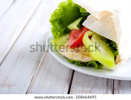 tortilla wrap with chicken and vegetables, selective focus
