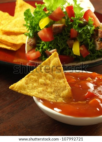 Tortilla wrap with crispy nachos with sauce - stock photo