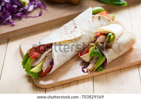 tortilla wrap with grilled chicken,avocado,tomato and lettuce