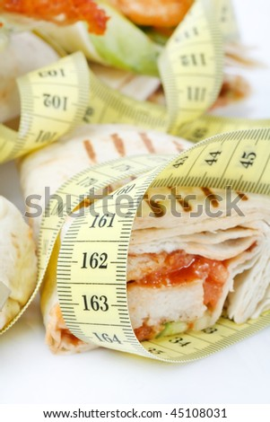 Tortilla wrap with tape measure - stock photo