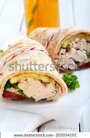 tortilla wrap with vegetable and chicken fillings