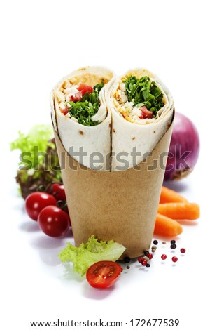 tortilla wraps with chicken and fresh vegetables isolated on white