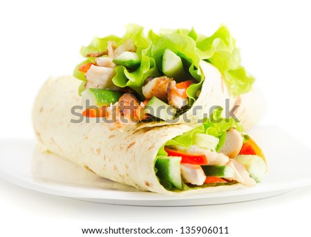 tortilla wraps with chicken and fresh vegetables isolated on white. Selective focus - stock photo