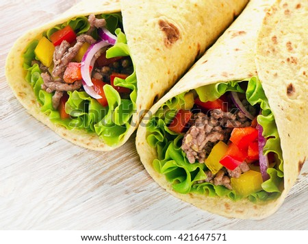 Tortilla wraps with meat and vegetables.  - stock photo