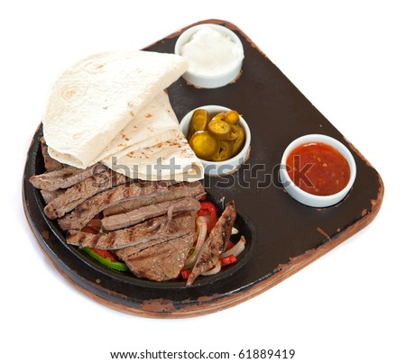 Tortillas with marinated steaks and sauces - stock photo