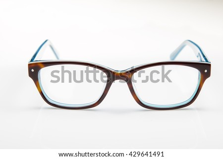 Tortoise shell and blue eyeglass frames on a white background