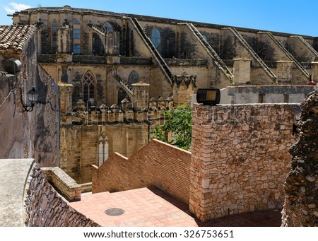 Tortosa cathedral lateral view from the castle, Tortosa, Tarragona province, Spain. - stock photo