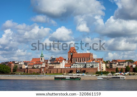 Torun in Poland, Old Town skyline, fortified medieval city, river view.